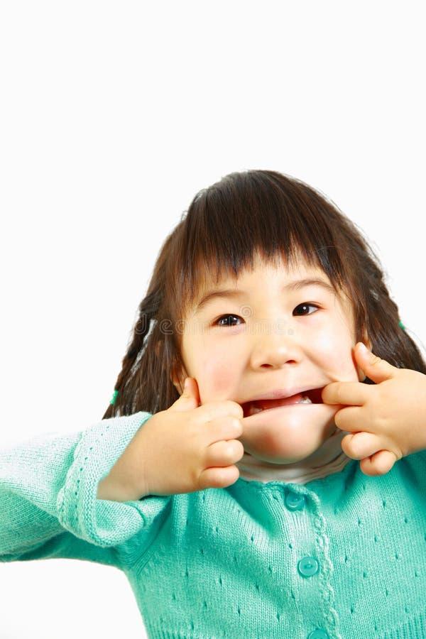 Jogo japonês pequeno da menina o tolo imagens de stock