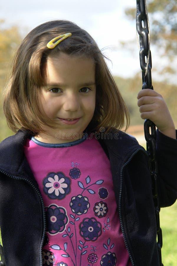 Jogo tímido da menina foto de stock
