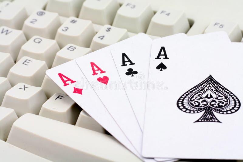 Jogos de cartão em linha foto de stock royalty free