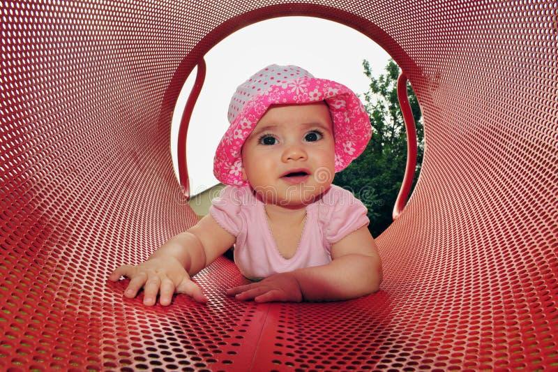 Jogos do bebé no campo de jogos imagens de stock royalty free