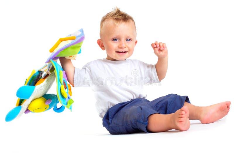Jogos do bebê com brinquedos imagens de stock royalty free