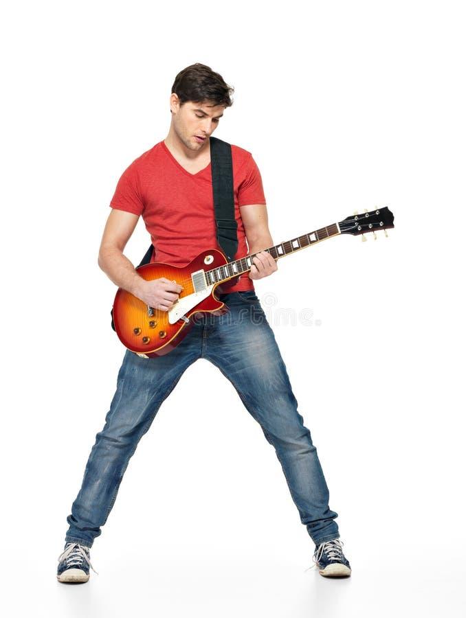 Jogos do homem do guitarrista na guitarra elétrica fotos de stock royalty free