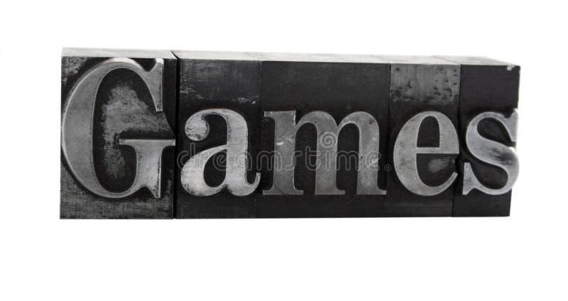 ?jogos? no tipo velho do metal imagem de stock