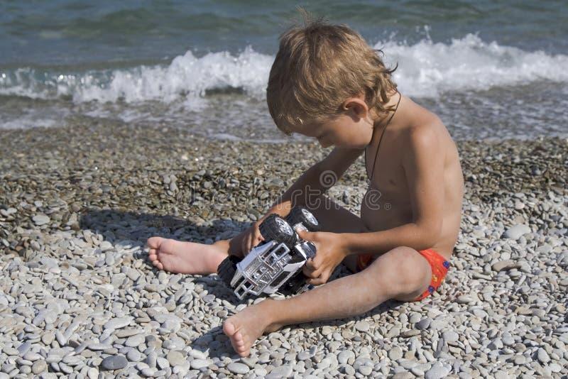 Jogos pequenos um carro do brinquedo fotos de stock royalty free