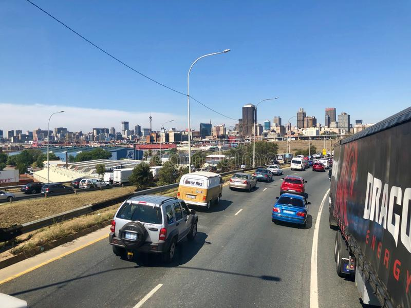 Johannesburg Central Business District buildings and roads as seen from out of a driving car. royalty free stock photo