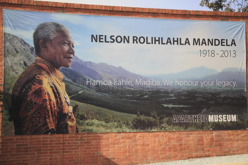 Johannesburg. The Museum of Apartheid. Photo of N.Mandela`s portrait on a poster on the wall of red brick of the museum of Apartheid in Johannesburg in daylight stock photo