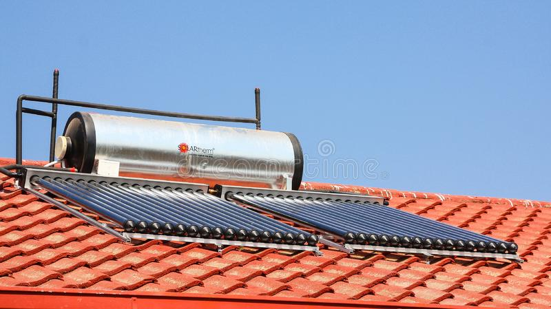 Solar Water Heating Tubes on a roof. Johannesburg, South Africa - August 28 2010: Solar Water Heating Tubes on a roof stock photos
