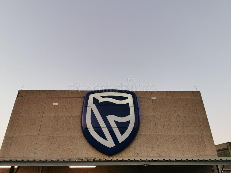 Johannesburg , South Africa - 10 Jan 2020: Standard Bank employee`s parking showing standard Bank logo in Simmonds Street ,. Marshalltown stock photo