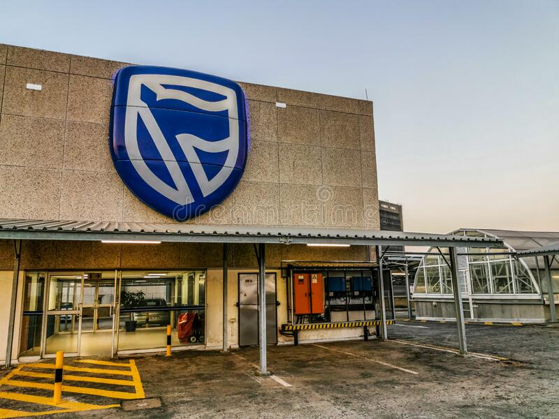 Johannesburg , South Africa - 10 Jan 2020: Standard Bank employee`s parking showing standard Bank logo in Simmonds Street ,. Marshalltown stock photography