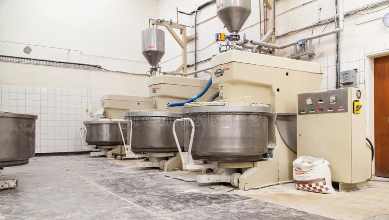 Industrial bread dough mixers in bakehouse. stock image