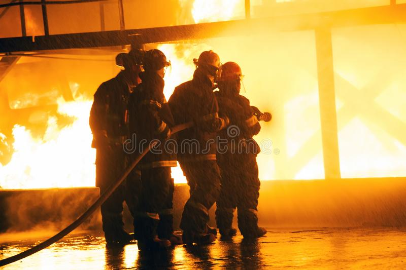 JOHANNESBURG, SOUTH AFRICA - MAY, 2018 Closeup of firefighters fighting fire during a firefighting training exercise royalty free stock photos
