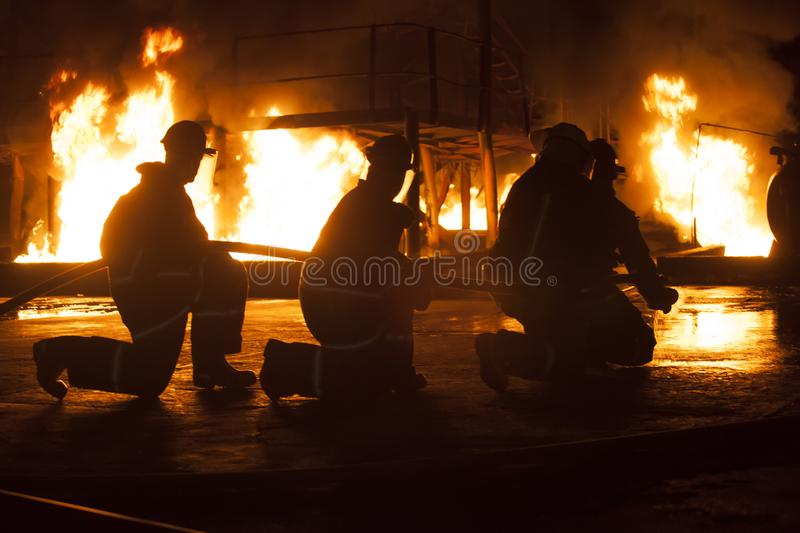 JOHANNESBURG, SOUTH AFRICA - MAY, 2018 Firefighters kneeling during a firefighting training exercise stock photography