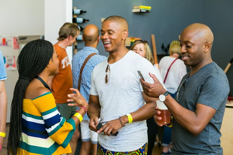 African Friends eating, drinking and generally enjoying a day out at a Food and Wine Fair. Johannesburg, South Africa - October 15 2016: African Friends eating stock images