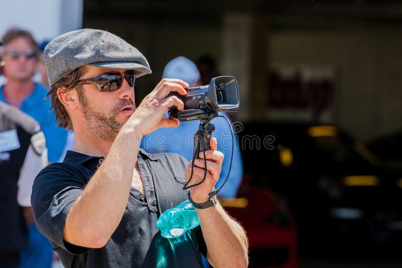 Jay Kay of Jamiroquai filming on a camcorder. Johannesburg, South Africa - October 05 2013: Jay Kay of Jamiroquai filming on a camcorder royalty free stock photos