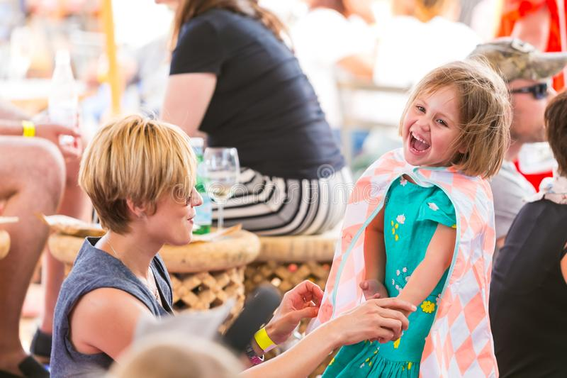 Mother and daughter laughing  and generally enjoying a day out at a Food and Wine Fair stock image