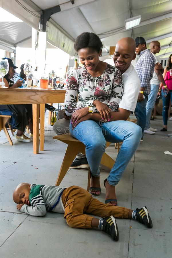 A young African family enjoying a day out at a Food and Wine Fair drinking and generally enjoying a day out at a Food and Wine. Johannesburg, South Africa stock photos