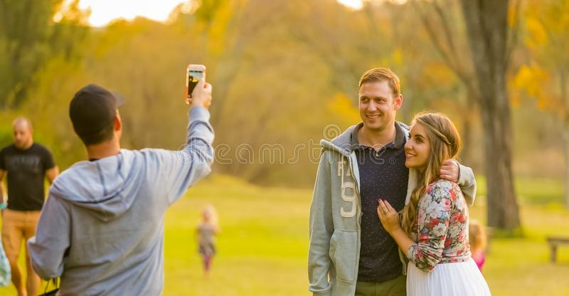 Young beautiful couple posing for a selfie at The Winter Sculpture Fair at Nirox Sculpture Park stock image