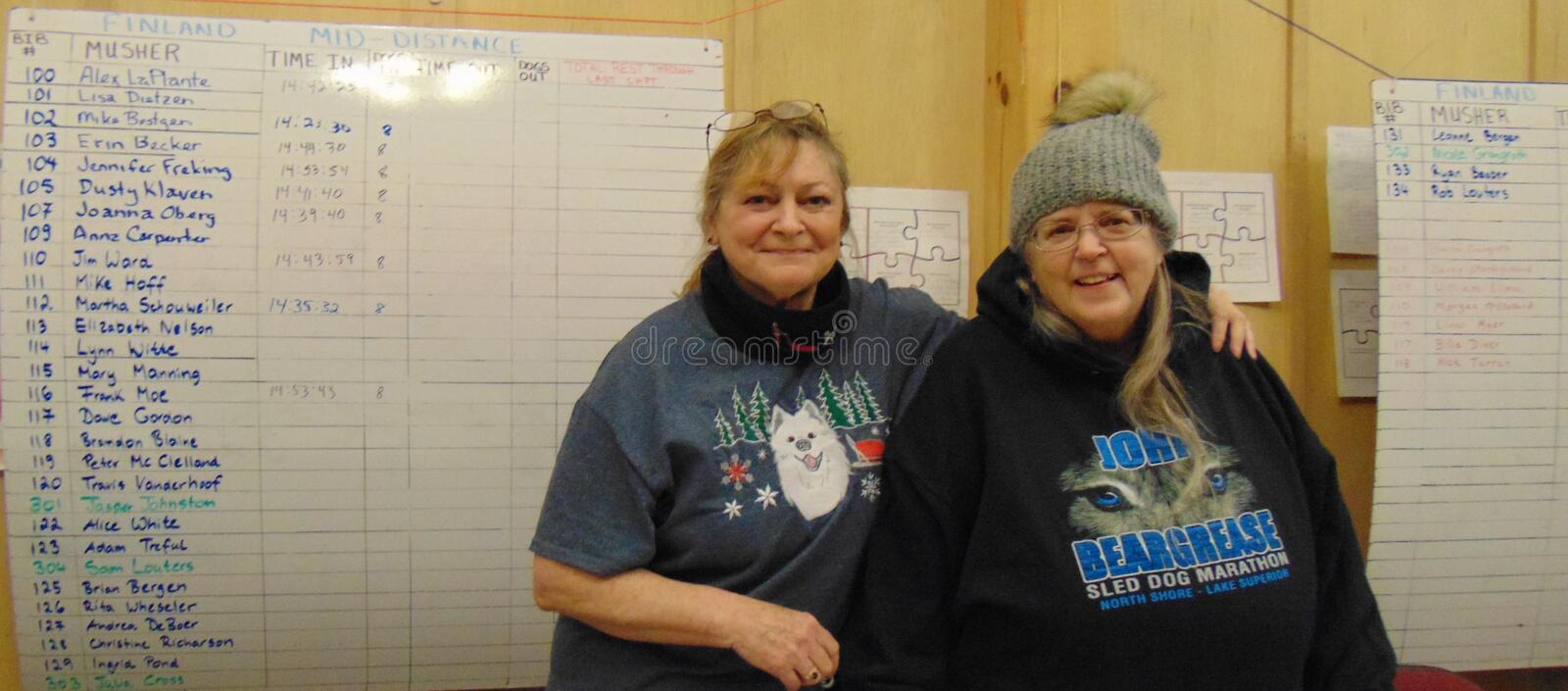 John Beargrease Sled Dog Marathon 2018 Finland Checkpoint volunteers Glori and Joyce with early times in the background stock photo