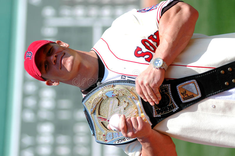 John Cena WWE with belt. Displaying his championship belt John Cena throws out the first pitch stock images