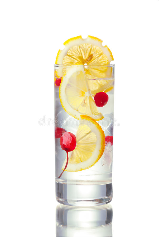 John Collins alcoholic cocktail. In highball glass decorated with lemon slice. IBA official cocktail royalty free stock photos