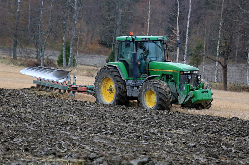 John Deere 8100 Agricultural Tractor and Kverneland PB100 Plough stock image