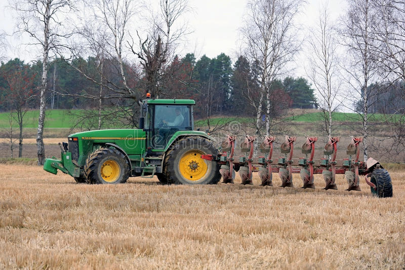 John Deere 8100 Agricultural Tractor and Kverneland PB100 Plough stock photo