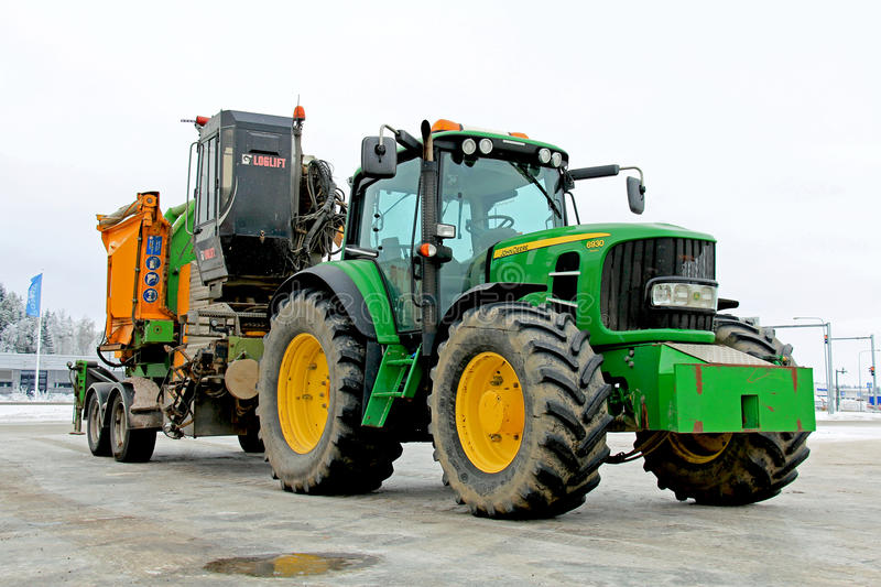 John Deere 6930 Agricultural Tractor with Wood Chipping Machine stock photos
