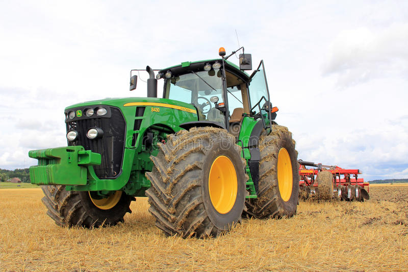 John Deere 8430 Agricultural Tractorand Cultivator stock image