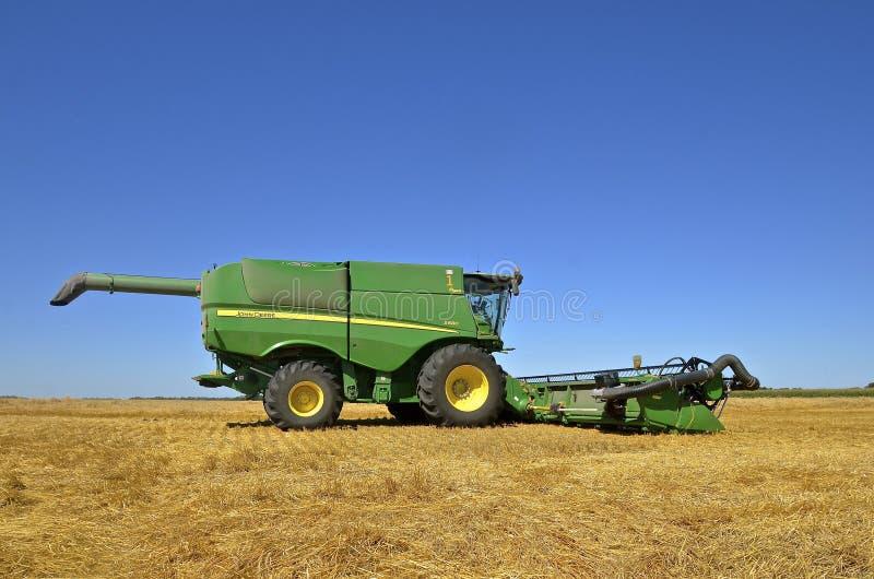 Download John Deere Combine Parked In Wheat Field Editorial Photo