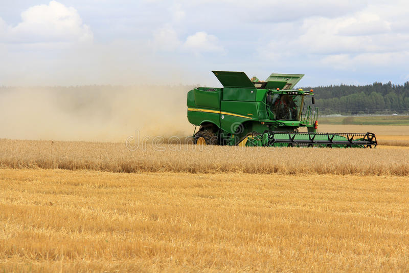 John Deere Combine s670i Harvesting Barley royalty free stock photo