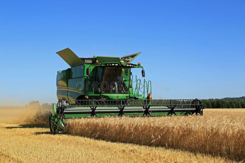 John Deere Combine s670i Harvests Barley stock photos