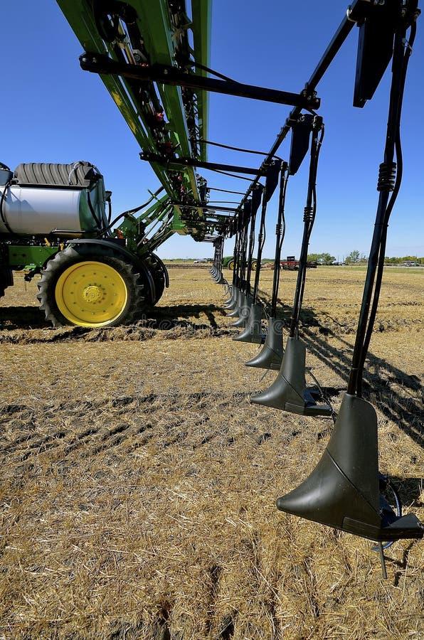 John Deere demonstration of a new crop sprayer. WEST FARGO, NORTH DAKOTA, September 13, 2016. A new John Deere computerized spraying tractor and booms is doing a stock photography