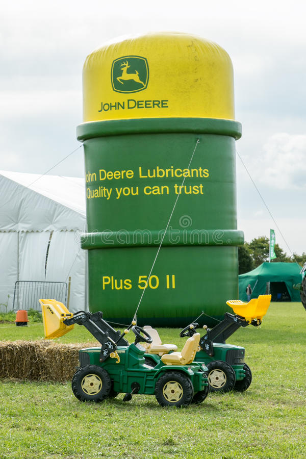 John deere logo on inflatable oil can stock photos