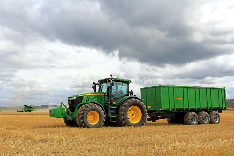 John Deere Tractor and Combine Harvesting royalty free stock image