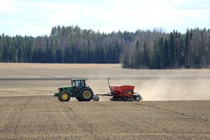 John Deere Tractor and Seeder at Work on Field royalty free stock photo
