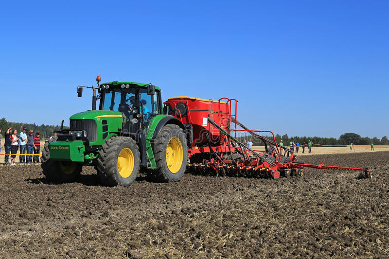 John Deere 7430 Tractor and Vaderstad Spirit 600C Seed Drill on royalty free stock image
