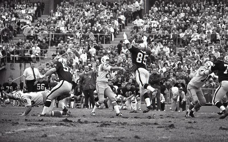 John Hadl QB of the San Diego Chargers. Chargers QB John Hadle #21 gets a pass through Raiders DL Carleton Oats #85, October 13, 1968. Image taken from b&w royalty free stock photos