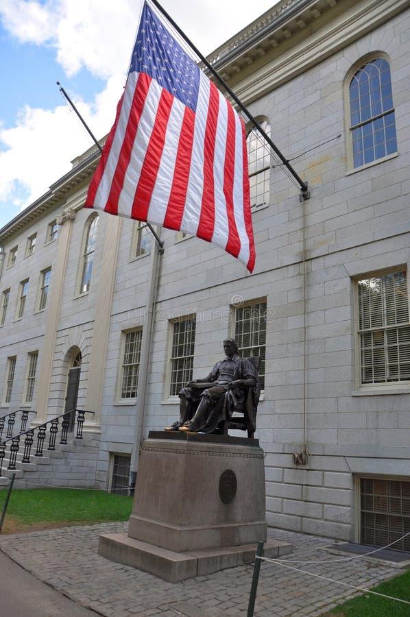 John Harvard Statue in Harvard University. John Harvard statue and USA national flag in Harvard University in Boston, USA stock image
