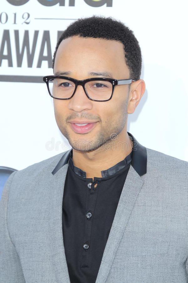 John Legend arrives at the 2012 Billboard Awards. LAS VEGAS - MAY 20: John Legend arrives at the 2012 Billboard Awards at MGM Garden Arena on May 20, 2012 in Las royalty free stock images