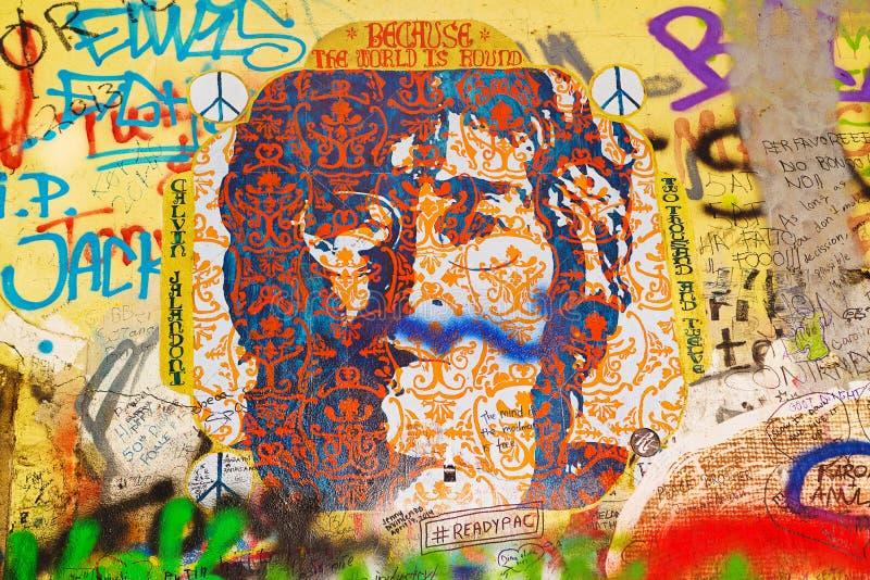 John Lennon Graffiti Wall on Kampa Island in Prague. PRAGUE, CZECH REPUBLIC - SEPTEMBER 11, 2014: Famous John Lennon Wall on Kampa Island in Prague is filled stock image