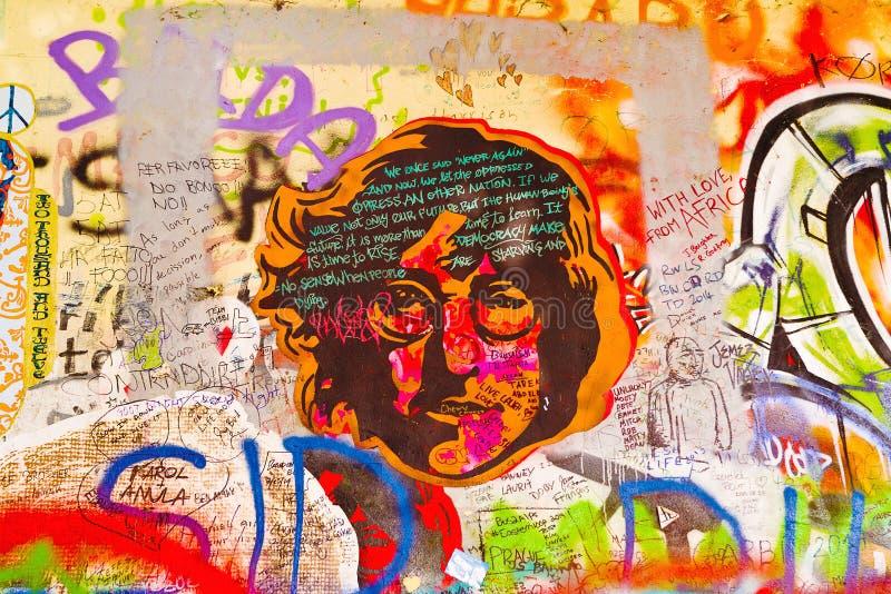 John Lennon Graffiti Wall on Kampa Island in Prague. PRAGUE, CZECH REPUBLIC - SEPTEMBER 11, 2014: Famous John Lennon Wall on Kampa Island in Prague is filled stock photos