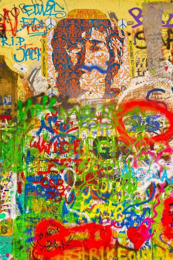 John Lennon Graffiti Wall on Kampa Island in Prague. PRAGUE, CZECH REPUBLIC - SEPTEMBER 11, 2014: Famous John Lennon Wall on Kampa Island in Prague is filled stock photo