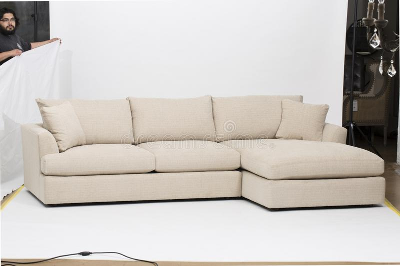 John Lewis & Partners Bailey RHF Chaise End Sofa Bed, A luxury sofa inspired by Italian design, Amalfi has leather upholstery royalty free stock photography