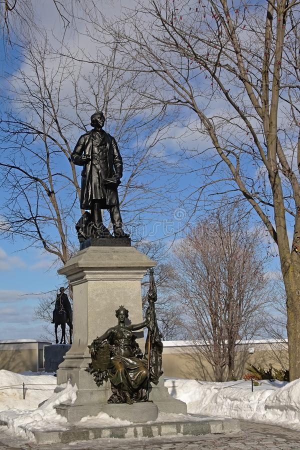 John macdonald statue on parliament hill in Ottawa. Jbronze ohn macdonald statue on parliament hill in Ottawa, capital of Canada on a sunny winter day with snow stock photos