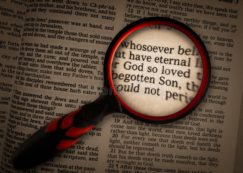 John 316 magnified. Concept of john 3:16 magnified by a magnifying glass stock photography