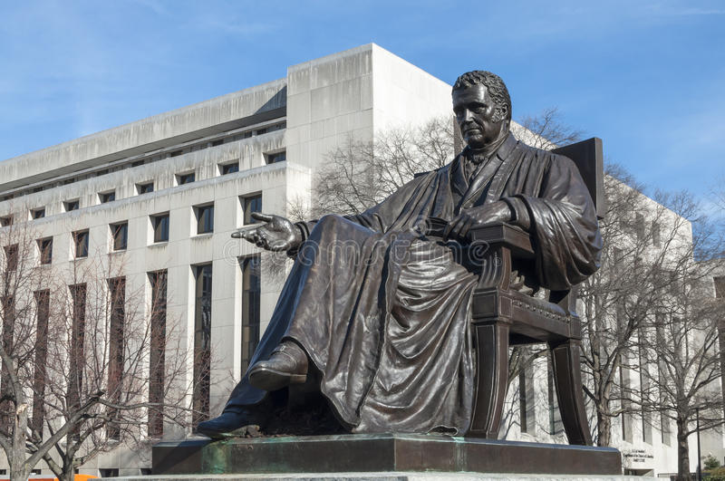 John Marshall statue. Bronze statue of John Marshall, fourth chief justice of the Supreme Court, located in John Marshall Place Park with U.S. Supreme Court royalty free stock photos