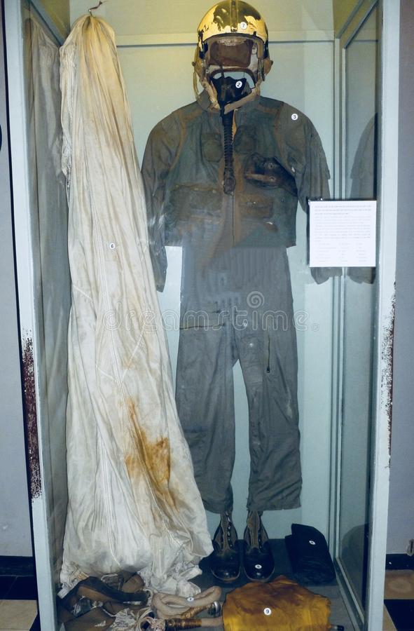 The flight suit, parachute and gear John McCain was captured in by the North Vietnamese, on display at the Hanoi Hilton Museum. royalty free stock photos