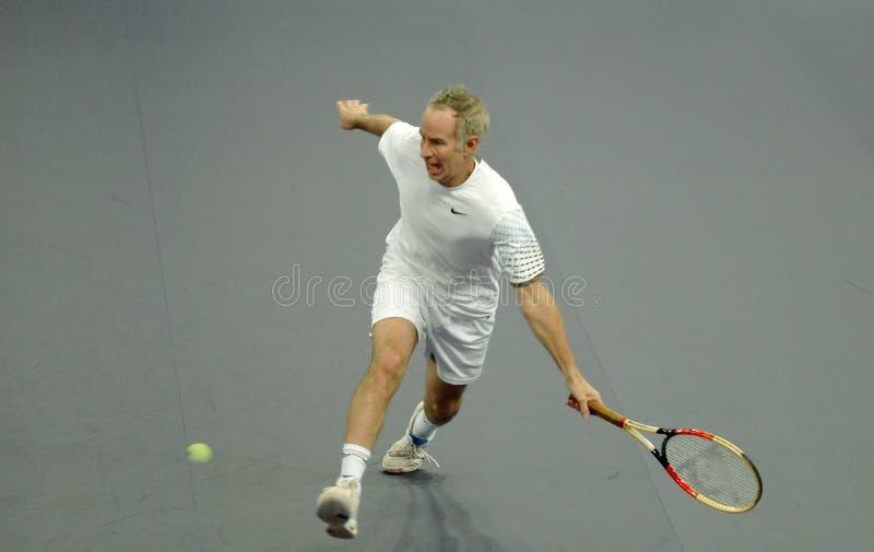 John McEnroe in acties stock afbeeldingen