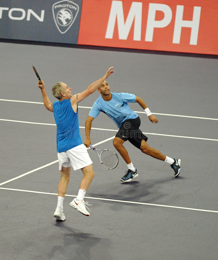 John McEnroe and James Blake in actions. Tennis players John McEnroe and James Blake of the U.S actions during an exhibition tennis match against Roger Federer royalty free stock images