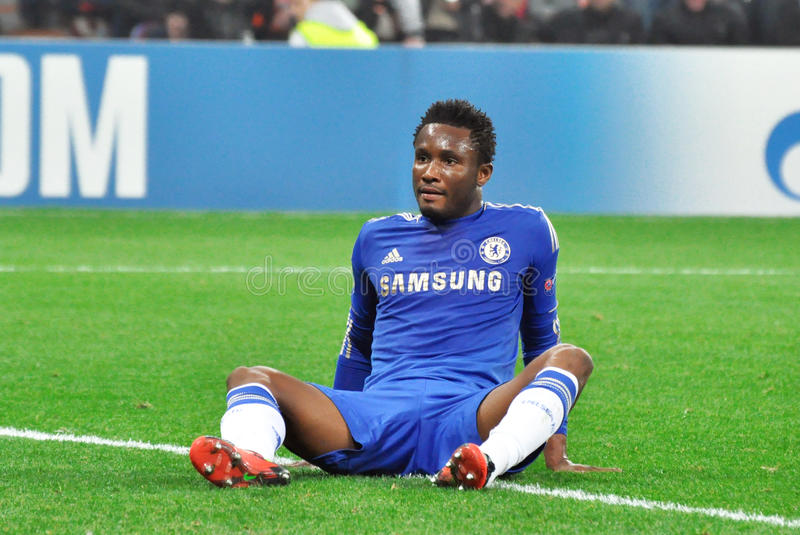 Download John Obi Mikel Is Sitting On The Field Editorial Photo - Image: 27347691